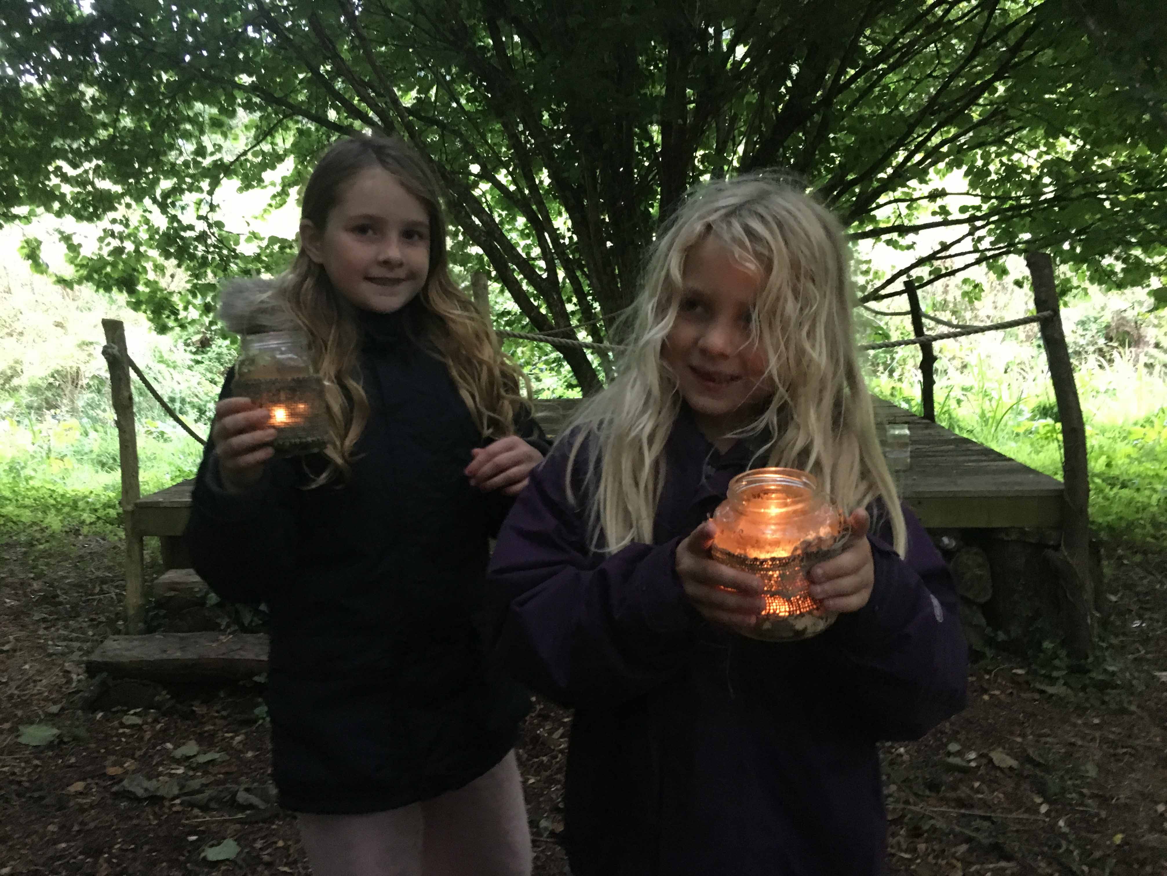Recent campers with tealights at Wilton Farm campsite wooded Glade